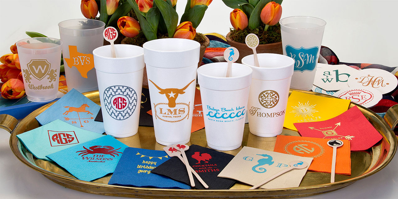 custom cups, personalized napkins, printed stir sticks and coasters with Signature Collection art